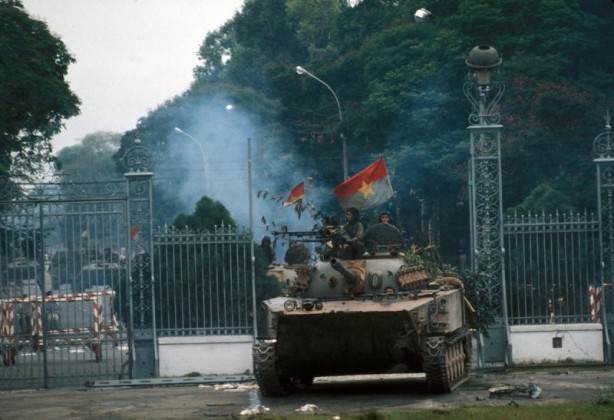 VIETNAM - CIRCA 1975:  War of Vietnam. Saigon's fall. Taken of the presidential palace. North - Vietnamese armored car crossing the railings. April 30, 1975.  (Photo by Francoise De Mulder/Roger Viollet/Getty Images)